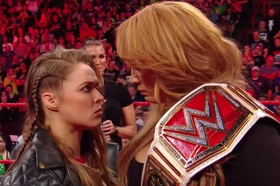 WWE-Raw-Rousey-Jax-have-stare-down-Reigns-and-Rollins-team-up