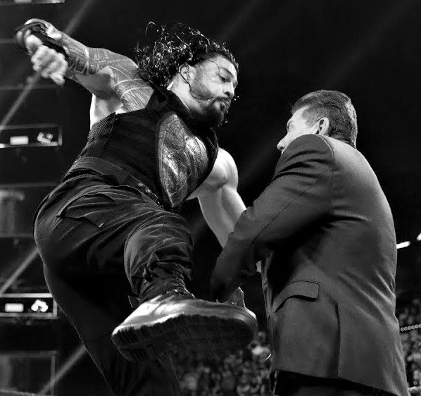 Roman Reigns Punches Vince